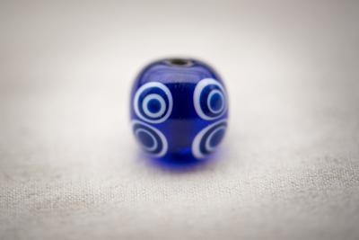 Náhled výrobku: Keltský korálek s osmi oky - tmavěmodrý